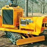 The hydraulically controlled blade on the Hurricane RS allows the operator to backfill the stump hole quickly and easily. The track system provides plenty of power to push even the largest piles!